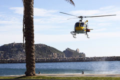 Rescue helicopter and sea Stock Image