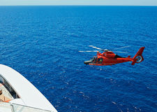 Rescue helicopter at sea Stock Photos