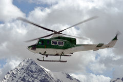 Rescue helicopter. In the sky above the Alps royalty free stock image