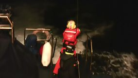 Rescue helicopter. The helicopter of the Spanish Maritime Rescue Team  Salvamento Maritimo training over the deck of a coast guard ship in Spanish coast stock video