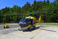 Rescue helicopter. Standing on the landing pad stock images