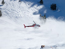 Rescue helicopter in swiss alps Stock Images