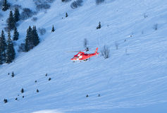 Rescue helicopter in swiss alps Royalty Free Stock Photography