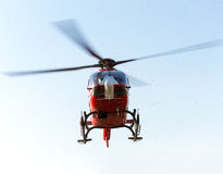 Rescue helicopter takes off. Red rescue air ambulance helicopter takes off during an emergency call royalty free stock image