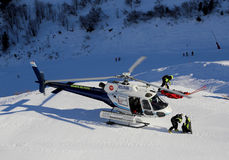 Rescue helicopter. A rescue helicopter taking a casualty off the mountain royalty free stock photo