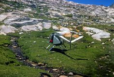 Rescue helicopter taking off from high mountain meadow Stock Photos