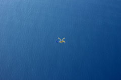 Rescue Helicopter in Vast Ocean Aerial View. Aerial view of Rescue Helicopter in Vast Ocean stock photography