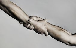 Rescue, helping gesture or hands. Strong hold. Two hands, helping hand of a friend. Handshake, arms, friendship