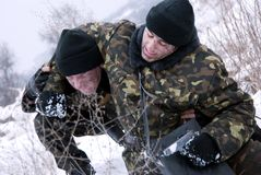 Rescue of injured of soldier. Winter forest. Snow. Soldiers royalty free stock photography