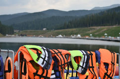 Rescue jackets in mountains lake. Life jackets on the background lale and mountains Stock Photo