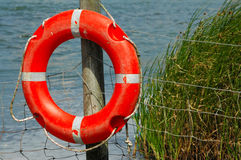 Rescue life ring. S on a river fence Royalty Free Stock Image