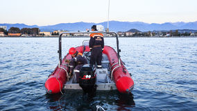 Rescue Marine Service towing a broken boat from the sea Stock Photos