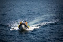 Rescue Marine Vessel During A Rescue Operation At Sea. A Motor Boat With Lifeguards Moves By Sea. Royalty Free Stock Image