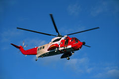 Rescue Operation. The rescue helicopter and his crew in action Royalty Free Stock Images