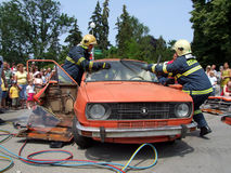 Rescue operation at autoaccident Stock Photos