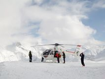 Rescue operation with helicopter on a ski slope in the ski resort of Tignes, the Alps France. Rescue operation with helicopter on a ski slope in the ski resort royalty free stock photo