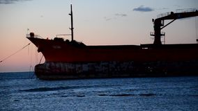Rescue operations of cargo ship aground stock video footage