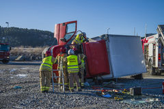 Rescue of an person in a overturned panel van Stock Photography