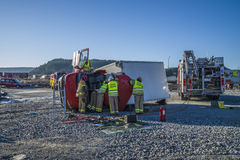 Rescue of an person in a overturned panel van Stock Images