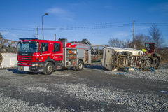 Rescue of an person in a overturned panel van Royalty Free Stock Photography
