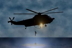 Rescue of the Person at Sea by Helicopter Royalty Free Stock Photography