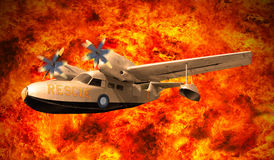 Rescue plane flying over fire burning Royalty Free Stock Images