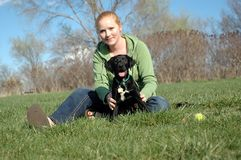 Rescue puppy and young woman Stock Image