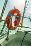 Rescue red lifebuoy life preserver saver ring on sailboat. Yachting in summer time Stock Images