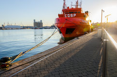 Rescue red ship moor by the rope in port of Tarragona, Spain Royalty Free Stock Images