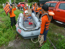 Rescue. R is preparing a boat to search for corpses drifting in the river in the city of Solo, Central Java, Indonesia Royalty Free Stock Photo