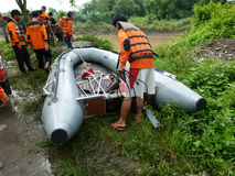 Rescue. R is preparing a boat to search for corpses drifting in the river in the city of Solo, Central Java, Indonesia Royalty Free Stock Photography