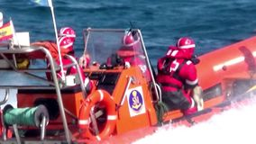 Rescue rigid hulled boat of Red Cross sailing fast. Group of rescue of the South East Mediterraneam team of Alicante city working with a difficult sea in the stock video footage