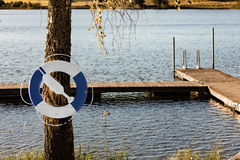 Rescue ring by a lake Royalty Free Stock Images