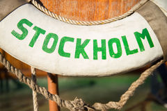 Rescue ring with Stockholm sign. Detail of rescue ring with Stockholm sign in green letters Royalty Free Stock Images