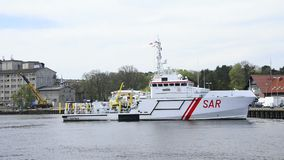 Rescue SAR boat coming into the port of Ustka stock video footage