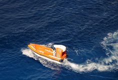 Rescue at sea. Boat conducting search and rescue operation at sea Royalty Free Stock Images