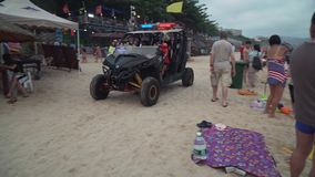 Rescue service buggy monitors the security of people on the beach of Dadonghai stock footage video stock video