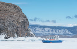 Rescue ship on an air cushion. Hovercraft. Hovercraft. Ice on the surface of the transparent frozen Lake Baikal. Transport on ice. A lifeboat on an air cushion Royalty Free Stock Images