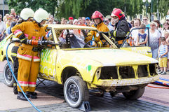 Rescue simulation of accident. Grodno, Belarus - July 25 2016: Simulation of road accidents, joint intervention between firefighters and rescuers Royalty Free Stock Photography