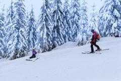 Rescue ski patrol help injured woman skier Stock Image