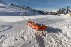 Rescue sled in the snow. Transport sleigh for injured skiers. Prepare ski slope, Alpe di Lusia, Italy Stock Photo