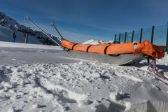 Rescue sled in the snow. Transport sleigh for injured skiers. Prepare ski slope, Alpe di Lusia, Italy Royalty Free Stock Image