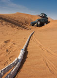 Rescue of stuck 4x4. Two cars off-road one stuck in sand royalty free stock photography