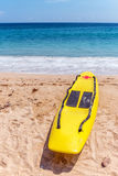 Rescue surfboard on the beach. Stock Image