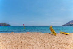 Rescue surfboard on the beach. Royalty Free Stock Images