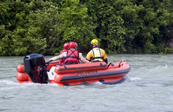 Rescue Team. Fire and Rescue emergency team conducting a practice drill on a river after several days of heavy rain Stock Images