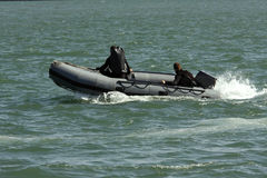 Rescue team. In action on a inflatable boat stock image