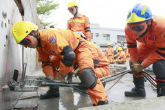 Rescue team. Taipei rescue team cut the cement to rescue victims in a drill on Mar. 30, 2009 in Taipei Royalty Free Stock Images