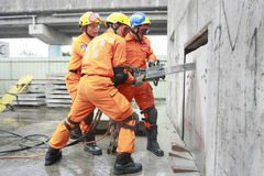 Rescue team. Taipei rescue team cut the cement to rescue victims in a drill on Mar. 30, 2009 in Taipei Royalty Free Stock Image
