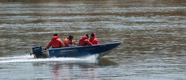 Rescue team on a boat Stock Images
